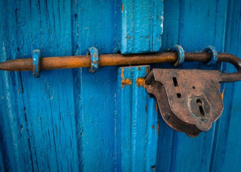 blue door with vintage lock